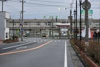 酒田駅前に降る雨の冷たさ